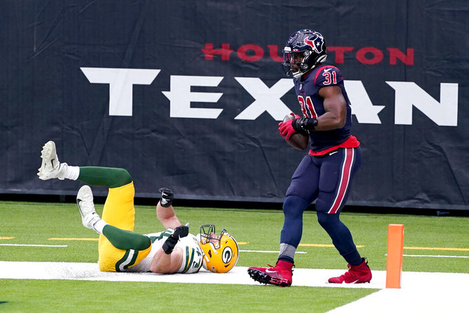 Houston Texans running back David Johnson (31) catches a touchdown pass as Green Bay Packers linebacker Ty Summers defends during the second half of an NFL football game Sunday, Oct. 25, 2020, in Houston. (AP Photo/Sam Craft)