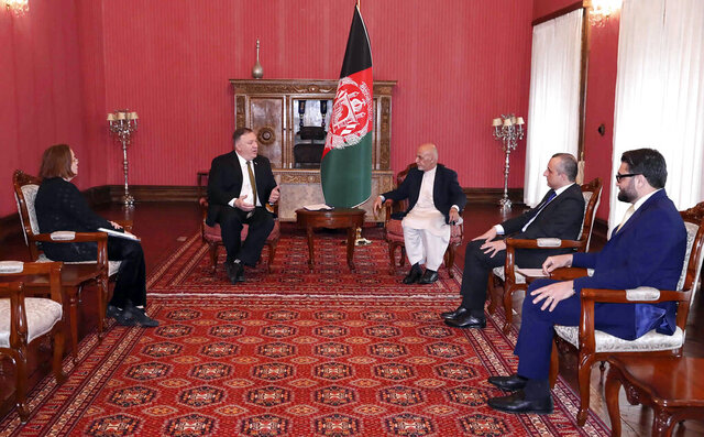 U.S. Secretary of State Mike Pompeo, center left, meets with Afghan President Ashraf Ghani, center right, at the Presidential Palace in Kabul, Afghanistan, Monday, March 23, 2020. Pompeo was in Kabul on an urgent visit Monday to try to move forward a U.S. peace deal signed last month with the Taliban, a trip that comes despite the coronavirus pandemic, at a time when world leaders and statesmen are curtailing official travel. (Afghan Presidential Palace via AP)