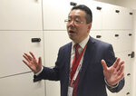 Bob Xie, the director of Huawei's new cybersecurity center in Brussels, gestures as he gives a tour of the new facility on Tuesday March 5, 2019. Chinese tech giant Huawei is opening a cybersecurity lab in Brussels, as it tries to win over European Union leaders in a geopolitical battle with the U.S. over allegations its equipment poses a national security risk. (AP Photo/Kelvin Chan)
