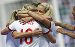 England's scorer Ellen White, front, and her teammates celebrate the opening goal during the Women's World Cup Group D soccer match between Japan and England at the Stade de Nice in Nice, France, Wednesday, June 19, 2019. (AP Photo/Claude Paris)
