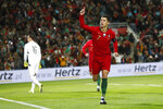 Portugal's Cristiano Ronaldo celebrates after scoring the opening goal during the Euro 2020 group B qualifying soccer match between Portugal and Lithuania at the Algarve stadium outside Faro, Portugal, Thursday, Nov. 14, 2019. Ronaldo scored a hat trick in Portugal's 6-0 victory. (AP Photo/Armando Franca)