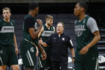 Michigan State head basketball coach Tom Izzo gives instructions during practice in East Lansing, Mich., Monday, Feb. 18, 2019. Izzo and Michigan coach John Beilein are friendly rivals, whose highly ranked NCAA college basketball teams will play for the first time this season on Sunday at Crisler Arena. As much as Beilein and Izzo genuinely like and respect each other, the highly competitive coaches want to win. (AP Photo/Paul Sancya)