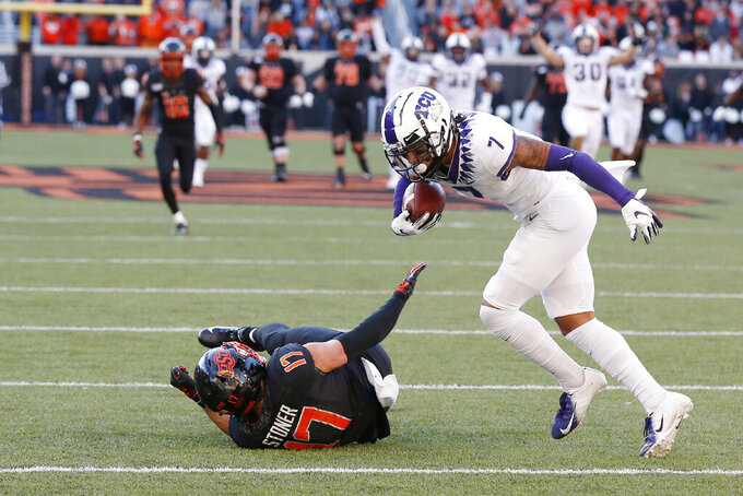 TCU safety Trevon Moehrig (7) comes down with the ball on an interception on a pass intended for Oklahoma State wide receiver Dillon Stoner (17) in the second half of an NCAA college football game in Stillwater, Okla., Saturday, Nov. 2, 2019. (AP Photo/Sue Ogrocki)