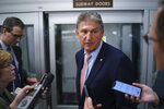 Sen. Joe Manchin, D-W.Va., a key infrastructure negotiator, pauses for reporters after working behind closed doors with other Democrats in a basement room at the Capitol in Washington, Wednesday, June 16, 2021. (AP Photo/J. Scott Applewhite)
