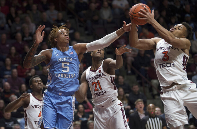 Virginia Tech guard Wabissa Bede (3) controls the rebound in front of North Carolina forward Armando Bacot (5) during the first half of an NCAA college basketball game in Blacksburg, Va., Wednesday, Jan. 22, 2020.(AP Photo/Lee Luther Jr.)