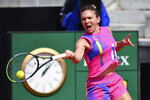 Romania's Simona Halep returns the ball to Italy's Jasmine Paolini during their match at the Italian Open tennis tournament in Rome, Wednesday, Sept. 16, 2020. (Alfredo Falcone/LaPresse via AP)