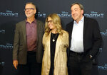 Director Chris Buck, left, director Jennifer Lee, center, and producer Peter Del Vecho, pose fot photos during a press conference to promote the film Frozen II, in Mexico City, Monday, Nov. 4, 2019. (AP Photo/Berenice Bautista)