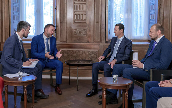 In this photo released by the Syrian official news agency SANA, Syrian President Bashar Assad, second right, meets with a Russian delegation in Damascus, Syria, Tuesday, Aug. 20, 2019. Assad said his forces' recent victories in the northwestern province of Idlib