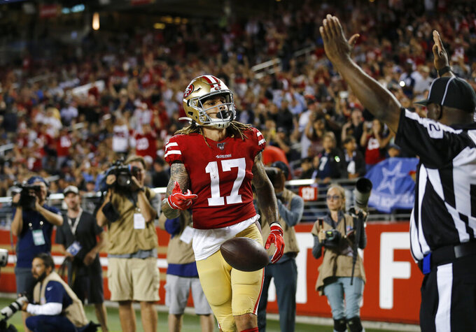 FILE - In this Aug. 10, 2019, file photo, San Francisco 49ers wide receiver Jalen Hurd (17) celebrates after scoring against the Dallas Cowboys during the second half of an NFL preseason football game in Santa Clara, Calif. Hurd went down with a knee injury that likely will sideline him for the season. Coach Kyle Shanahan said Monday, Aug. 17, 2020, that he believes the injury Hurd suffered the previous day in practice is a torn ACL that would be a season-ending injury. (AP Photo/Josie Lepe, File)