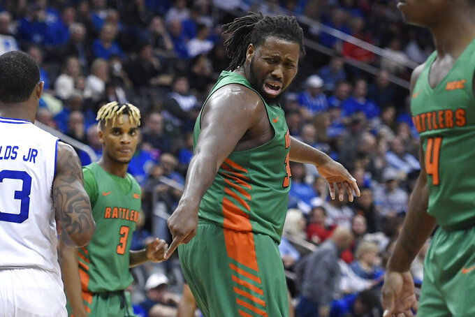 CORRECTS DATE - Florida A&M center Evins Desir (22) reacts after a call during the first half of an NCAA college basketball game against Seton Hall, Saturday, Nov. 23, 2019, in Newark, N.J. (AP Photo/Sarah Stier)