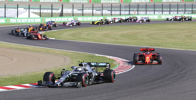 Mercedes driver Valtteri Bottas of Finland leads Ferrari driver Sebastian Vettel of Germany at the start of the Japanese Formula One Grand Prix at Suzuka Circuit in Suzuka, central Japan, Sunday, Oct. 13, 2019. (AP Photo/Toru Takahashi)