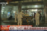 In this Thursday, Jan. 23, 2020, image from China's CCTV video, a patient is carried on a stretcher to an ambulance by medical workers in protective suits in Wuhan, China. China is swiftly building a hospital dedicated to treating patients infected with a new virus that sickened hundreds and prompted unprecedented lockdowns of cities home to millions of people during the country's most important holiday. (CCTV via AP)