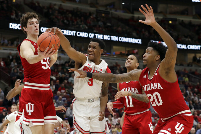Ohio State's C.J. Jackson (3) steals the ball from Indiana's Evan Fitzner (55) during the second half of an NCAA college basketball game in the second round of the Big Ten Conference tournament, Thursday, March 14, 2019, in Chicago. The Ohio State won 79-75. (AP Photo/Nam Y. Huh)
