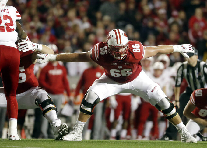 In this Oct. 6, 2018, file photo, Wisconsin's Beau Benzschawel blocks during the first half of an NCAA college football game against Nebraska in Madison, Wis. (AP Photo/Morry Gash, File)