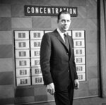 FILE - This Feb. 15, 1960 file photo shows host Hugh Downs on the set of the game show