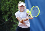 Belarus' Aljaksandra Sasnovich returns the ball to Italy's Jasmine Paolini during the Palermo Ladies Open tennis tournament in Palermo, Italy, Wednesday, Aug. 5, 2020. Tour-level tennis resumed after a five-month enforced break on Monday, and players at the Palermo Ladies Open had to handle their own towels and not shake hands of opponents. The strict rules because of the coronavirus included no showers on site, and no autographs or photos with fans. Players in the singles main draw come from 15 countries, all in Europe. (Palermo Ladies Open via AP)