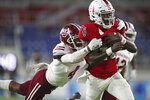Florida Atlantic quarterback Javion Posey is brought down near the end zone by Massachusetts defensive back Noah Boykin during the first quarter of an NCAA college football game Friday, Nov. 20, 2020, in Boca Raton, Fla. (John McCall/South Florida Sun-Sentinel via AP)