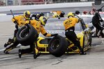 The pit crew scrambles as driver Brad Keselowski makes a pitstop during a NASCAR Cup Series auto race, Sunday, Aug. 2, 2020, at the New Hampshire Motor Speedway in Loudon, N.H. (AP Photo/Charles Krupa)