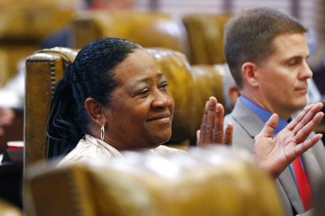 Rep. Hester Jackson-McCray, D-Horn Lake, applauds a group of 4-H leaders in the House chamber at the Capitol in Jackson, Miss., Feb. 5, 2020. The Republican controlled Mississippi House of Representatives, on a voice vote and without opposition, rejected a request by a Republican former lawmaker for a do-over in a close election in north Mississippi's DeSoto County. (AP Photo/Rogelio V. Solis)