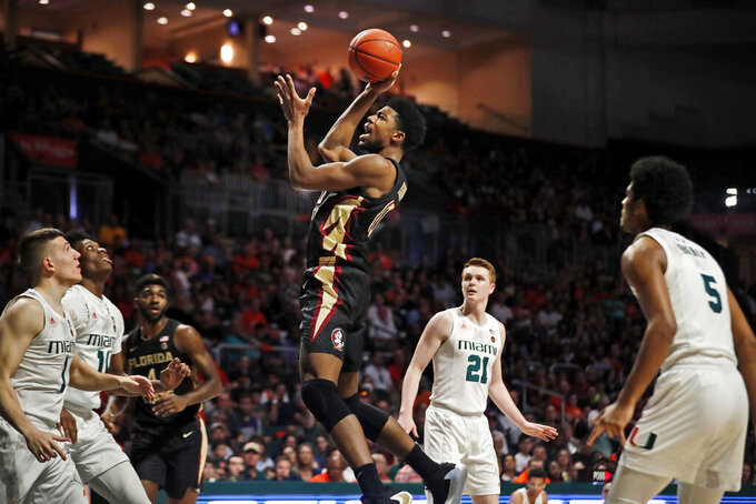 Florida State forward Malik Osborne (10) shoots the ball during the first half of an NCAA college basketball game against Miami on Saturday, Jan. 18, 2020, in Coral Gables, Fla. (AP Photo/Brynn Anderson)