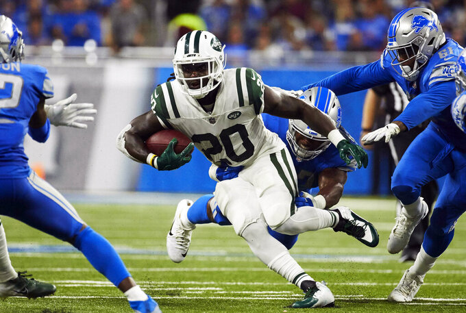 FILE - In this Sept. 10, 2018, file photo, New York Jets running back Isaiah Crowell (20) rushes against the Detroit Lions during an NFL football game at Ford Field in Detroit. The Oakland Raiders filled two more holes on their depth chart Thursday, March 28, 2019, by signing linebacker Brandon Marshall and running back Isaiah Crowell to one-year contracts. (AP Photo/Rick Osentoski, File)
