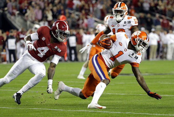 Clemson's Trayvon Mullen intercepts a pass during the first half in the NCAA college football playoff championship game against Alabama, Monday, Jan. 7, 2019, in Santa Clara, Calif. (AP Photo/David J. Phillip)