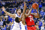 FILE- In this Nov. 15, 2018, file photo, Ohio State's Andre Wesson (24) is defended by Creighton's MitchBallock, left, and Ty-ShonAlexander (5), in an NCAA college basketball game in Omaha, Neb. A strong finish to last year's regular season could not push Creighton into the NCAA Tournament. The Bluejays are using the disappointment for motivation. Preseason All-Big East pick Alexander is among four returning starters. Marcus Zegarowski, Davion Mintz and Mitch Ballock also are back. (AP Photo/Nati Harnik, file)