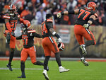 Cleveland Browns cornerback Denzel Ward (21) and teammates celebrate after they defeated the Buffalo Bills in an NFL football game, Sunday, Nov. 10, 2019, in Cleveland. (AP Photo/David Richard)
