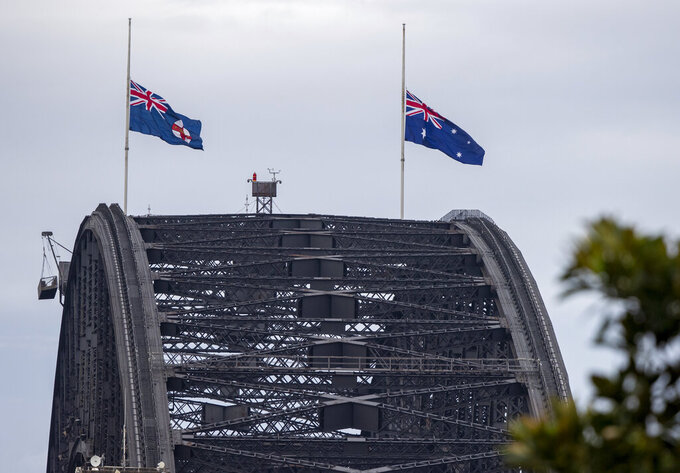 Flags fly at half-staff on the Sydney Harbour Bridge in Sydney as a tribute to Prince Philip, Saturday, April 10, 2021. Buckingham Palace officials say Prince Philip, the husband of Queen Elizabeth II, has died. He was 99. Philip spent a month in hospital earlier this year before being released on March 16 to return to Windsor Castle. (AP Photo/Mark Baker))