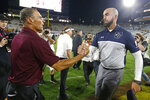 Arizona State coach Herm Edwards, left, and Kent State coach Sean Lewis meet following an NCAA college football game Thursday, Aug. 29, 2019, in Tempe, Ariz. Arizona State won 30-7. (AP Photo/Ralph Freso)