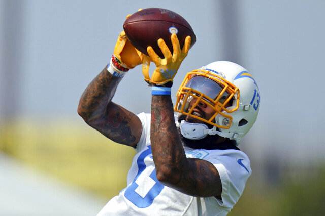 FILE - In this Aug. 19, 2020, file photo, Los Angeles Chargers wide receiver Keenan Allen makes a catch during NFL football camp in Costa Mesa, Calif. Allen has signed a four-year extension with the Chargers that will make him the league's second-highest paid receiver in average money. A person familiar with the deal says it is worth $80.1 million with $50 million guaranteed. The person spoke to The Associated Press on condition of anonymity because financial terms were not released by the Chargers on Saturday, Sept. 5, 2020. (AP Photo/Jae C. Hong, File)