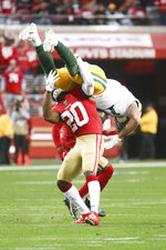 San Francisco 49ers free safety Jimmie Ward (20) upends Green Bay Packers wide receiver Geronimo Allison (81) during the NFL NFC Championship football game against the Green Bay Packers, Sunday, Jan. 19, 2020 in Santa Clara, Calif. The 49ers defeated the Packers 37-20. (Margaret Bowles via AP)