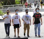 Students arrive at the Student Union at the University of Central Florida, in Orlando, Monday, August 24, 2020, on the first day of classes with new safety protocols in place to fight the coronavirus pandemic. (Joe Burbank/Orlando Sentinel via AP)