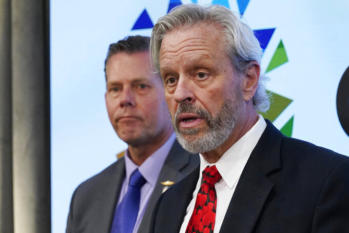 Don Knight, right, attorney for Oklahoma death row inmate Richard Glossip, speaks at a news conference Wednesday, June 16, 2021, in Oklahoma City. State Rep. Kevin McDugle, R-Broken Arrow, is at left. Thirty-four Oklahoma lawmakers, including 28 Republicans, are calling for reopening the investigation that led to Glossip's conviction. (AP Photo/Sue Ogrocki)