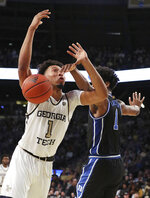 January 8, 2020 Atlanta: Georgia Tech forward James Banks III is fouled by Duke forward Vernon Carey, Jr., during the first half of an NCAA college basketball game Wednesday, Jan. 8, 2020, in Atlanta. (Curtis Compton/Atlanta Journal-Constitution via AP)