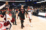 Washington Wizards guard Bradley Beal (3) and Chicago Bulls guard Zach LaVine (8) walk on the court after an NBA basketball game, Tuesday, Feb. 11, 2020, in Washington. The Wizards won 126-114. (AP Photo/Nick Wass)