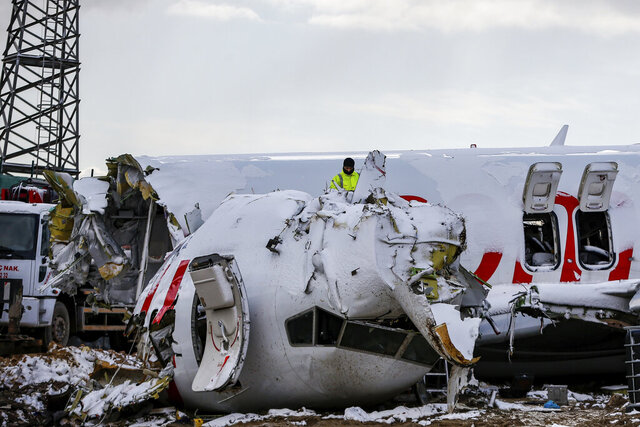 Workers remove the wreckage after investigators has finished their work at the Pegasus Airlines plane that skidded Wednesday off the runway at Istanbul's Sabiha Gokcen Airport, in Istanbul, Saturday, Feb. 8, 2020. Foreign and local investigators has examined the plane before the removal of its wreckage. (AP Photo/Emrah Gurel)