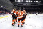 Philadelphia Flyers' Travis Konecny (11) celebrates with teammates after scoring a goal against the Dallas Stars during the second period of an NHL hockey game Thursday, Jan. 10, 2019, in Philadelphia. (AP Photo/Derik Hamilton)