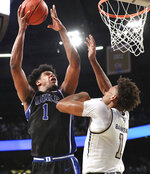 Duke forward Vernon Carey, Jr., goes to the basket against Georgia Tech forward James Banks III during the second half of an NCAA college basketball game Wednesday, Jan. 8, 2020, in Atlanta. (Curtis Compton/Atlanta Journal-Constitution via AP)