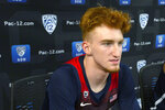 FILE - In this Oct. 8, 2019, file photo, Arizona's Nico Mannion speaks at the Pac-12 NCAA college basketball media day in San Francisco. Mannion, who averaged more 30 points for Pinnacle High School in Scottsdale, should team with Australian shooting guard Josh Green in giving the Wildcats an exciting backcourt. (AP Photo/D. Ross Cameron, File)