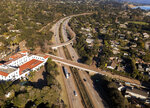 FILE - This Jan. 22, 2018 file photo from a news agency drone shows U.S. Highway 101 open to vehicle traffic in Montecito, Calif., after heavy rain brought flash flooding and mudslides that covered the highway two weeks earlier. In Utah, drones are hovering near avalanches to measure roaring snow. In North Carolina, they're combing the skies for the nests of endangered birds. In Kansas, meanwhile, they could soon be identifying sick cows through heat signatures. A survey released Monday, May 20, 2019 shows transportation agencies are using drones in nearly every U.S. state. (AP Photo/Daniel Dreifuss, File)