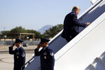 President Donald Trump boards Air Force One at Albuquerque International Sunport, Tuesday, Sept. 17, 2019, in Albuquerque, N.M. (AP Photo/Evan Vucci)