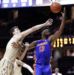 Vanderbilt forward Yanni Wetzell, left, and Florida center Kevarrius Hayes (13) reach for the ball during the second half of an NCAA college basketball game Wednesday, Feb. 27, 2019, in Nashville, Tenn. Florida won 71-55. (AP Photo/Mark Humphrey)