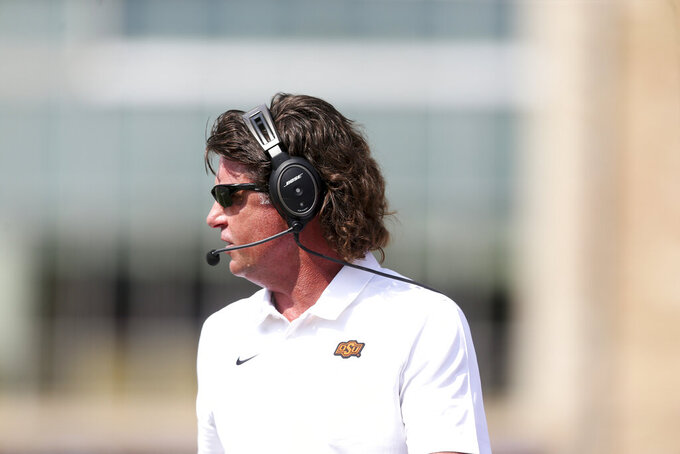 Oklahoma State Cowboys head coach Mike Gundy watches his team play during the NCAA football between the Oklahoma State Cowboys and the Tulsa Golden Hurricane at Skelly Field at H.A. Chapman Stadium in Tulsa, Okla. on Saturday, Sept. 14, 2019. (Ian Maule/Tulsa World via AP)