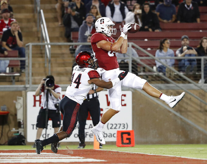 Stanford tight end Colby Parkinson (84) catches a touchdown pass against San Diego State safety Tariq Thompson (14) during the second half of an NCAA college football game Friday, Aug. 31, 2018, in Stanford, Calif. Stanford won 31-10. (AP Photo/Tony Avelar)