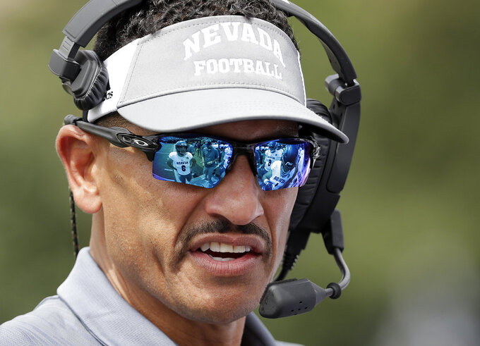 Nevada head coach Jay Norvell talks to his players in the second half of an NCAA college football game against Vanderbilt, Saturday, Sept. 8, 2018, in Nashville, Tenn. (AP Photo/Mark Humphrey)