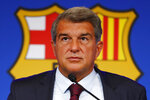 FC Barcelona club President Joan Laporta pauses during a news conference in Barcelona, Spain, Friday, Aug. 6, 2021. Barcelona announced on Thursday, Aug. 5, 2021 that Lionel Messi will not stay with the club. He is leaving after 17 successful seasons in which he propelled the Catalan club to glory, helping it win numerous domestic and international titles since debuting as a teenager. (AP Photo/Joan Monfort)