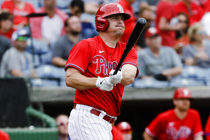 FILE - In this Feb. 25, 2020, file photo, Philadelphia Phillies' Jay Bruce bats during a spring training baseball game against the Toronto Blue Jays in Clearwater, Fla. Bruce agreed this month to a minor league contract with the New York Yankees that would pay a $1.35 million salary while in the major leagues and $150,000 while in the minors. If he's not added to the 40-man roster by March 25, he would have the right to opt out. (AP Photo/Frank Franklin II, File)