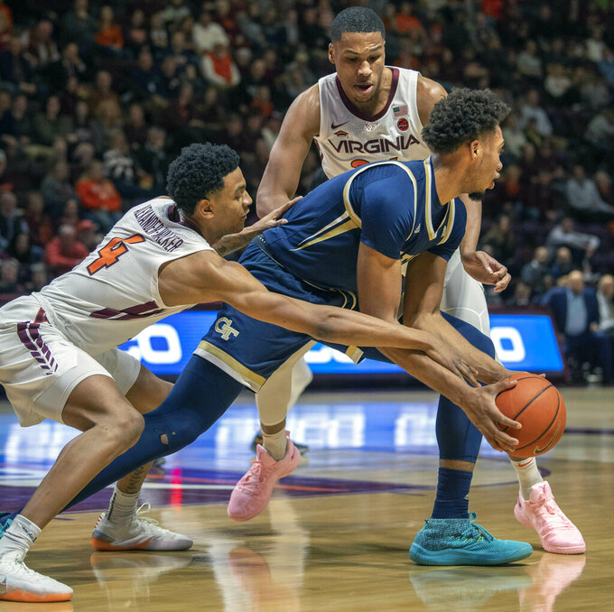 Virginia Tech guard Nickeil Alexander-Walker (4) and forward Kerry Blackshear Jr. look to steal the ball from Georgia Tech forward James Banks III during the first half of an NCAA college basketball game Wednesday, Feb. 13, 2019, in Blacksburg, Va. (AP Photo/Don Petersen)