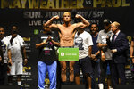 Logan Paul poses for photographers during a weigh-in Saturday, June 5, 2021, in Hollywood, Fla. Paul is scheduled to face Floyd Mayweather in an exhibition boxing match at Hard Rock Stadium in Miami Gardens, Fla., Sunday. (AP Photo/Jim Rassol)